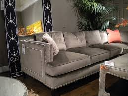 gray velvet sofa with nailhead trim