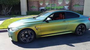 green bmw m4 bmw m4 color change avery color flow series gatorwraps