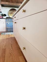 painting kitchen cabinets tutorial diy pink kitchen cabinets tutorial home decor eclectic twist