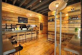 wooden paneling wall with black metal bar stools for warm coffee