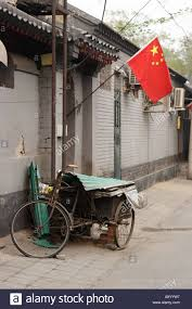 chinese flag hung on national day on a hutong lane hutongs are