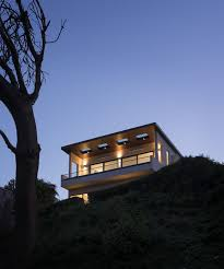 built on a steep slope and a narrow lot this 4000 square foot