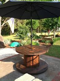 outdoor tables made out of wooden wire spools 20 diy wooden spools repurposing ideas quick and simple work