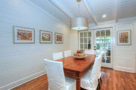 cottage dining room with hardwood floors by chic on the cheap