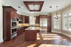 photos of kitchens with cherry cabinets reclaimed wood look floor tile in kitchen with cherry cabinets
