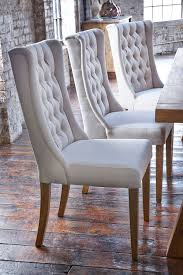 upholstered winged chairs will give your dining room an air of upholstered winged chairs will give your dining room an air of elegance we love