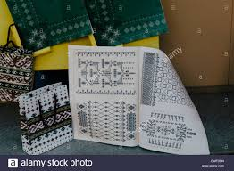 cross stitch pattern book showing patterns for traditional latvian