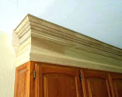 can you stain painted cabinets kitchen cabinets paint or stain psychics top