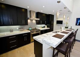cabinets drawer espresso flat panel kitchen cabinets chrome espresso flat panel kitchen cabinets chrome long handles white marble countertop white hanging pendant lights espresso bar stools light hardwood floors