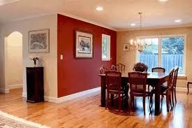 dark blue one side wall as an accent light wood parquet flooring