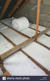 Insulation In Ceiling laying loft insulation in attic roofspace stock photo royalty