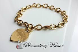 gold hearts charm bracelet images Tiffany co 18k yellow gold return to heart charm bracelet jpg