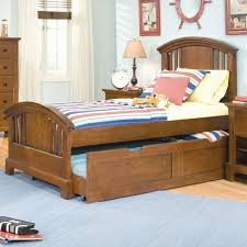 bedroom using pink trundle bed and nightstand with wall