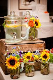 table centerpieces with sunflowers mason jar arrangements with stones at the bottom eventually