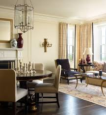 beige chairs living room traditional with gold accents gold wall