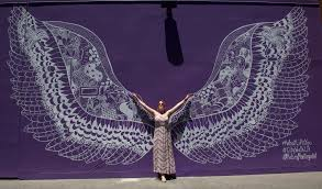del taco halloween horror nights universal citywalk gets its very own angel wings by artist and