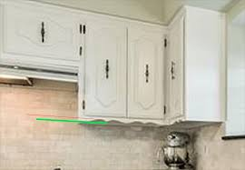 how to trim cabinets removing curvy decorative trim cabinets doityourself