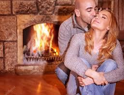 loving couple near fireplace u2014 stock photo anna om 61040587