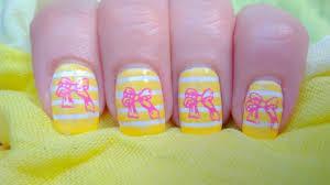 nail stamping design 13 yellow white stripes pink ribbon