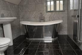 bathroom with dark tiles rdcny