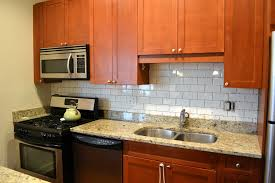 glass subway tile kitchen backsplash ideas with granite countertop