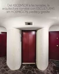 modern design hallway with putty grey wall and burgundy wine doors