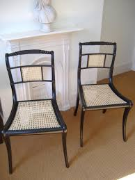 sabre leg cane chairs