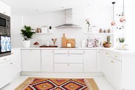 white kitchen subway tile backsplash copper pendant lights