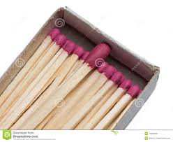 matchbox full of small matches and big one stock photography