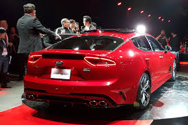 new cars prices in usa kia turns up the heat new stinger fastback unveiled in detroit by
