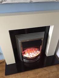 cream fire surround electric fire black marble hearth and