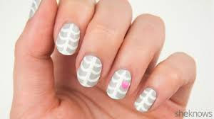 an adorable skeleton mani is yours with this halloween nail design