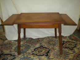extension table with pull out leaves at either end