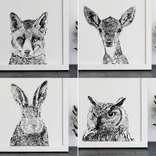 a set of four woodland animal portrait art prints by ros shiers
