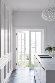 kitchen black and white granite with white cabinets white
