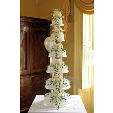 marjorie six tiered wedding cake decorated with hand crafted sugar