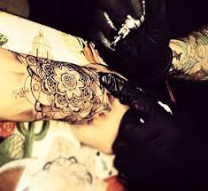 zayn malik gets new henna style flower wrist tattoo at l a tattoo