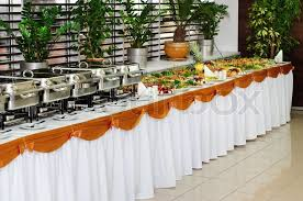 banquet table with chafing dish heaters and canapes stock photo