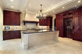 kitchen island cherry wood kitchen in luxury home with cherry wood paneling stock photo