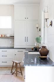 white kitchen cabinets soapstone countertops white kitchen cabinets contrasted with rubbed bronze
