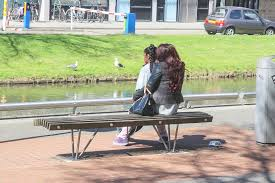 file black mother and daughter sitting on a bench jpg wikimedia