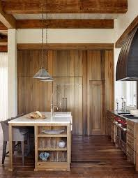 Rustic Cottage Kitchens - rustic kitchen with wall of stained oak pantry cabinets cottage