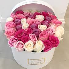 flowers in a box a beautiful arrangement of roses in varying shades of pink and
