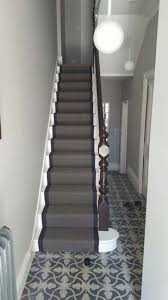 black carpet runner with black border to stairs the flooring