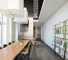 Interior Duplex Design Pitsou Kedem Designs Tel Aviv Apartment Featuring Dark Brass