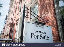 sign for townhouse for sale in greenwich village in new york on