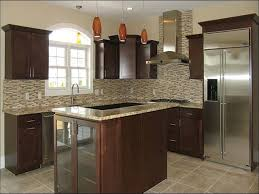 brown kitchen cabinets backsplash ideas santa cecilia granite with cabinets backsplash design