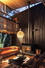 natural under pohutukawa house in piha new zealand home design