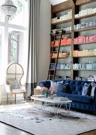 how to style a bookshelf behind your living room sofa bookshelf