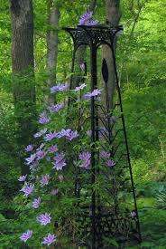 Eiffel Tower Garden Decor Lavender Blue Clematis Growing Up A Garden Tower Flower Garden